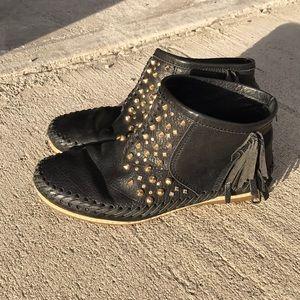 Black leather studded moccasins